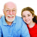 Pretty teen girl spending time with her handsome grandfather.